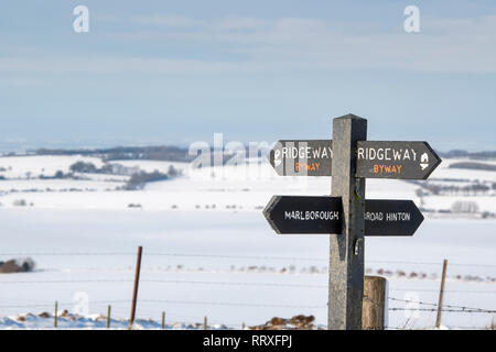 The Ridgeway signpost on top of Hackpen Hill in the snow covered wiltshire countryside. Hackpen Hill, Broad Hinton, Wiltshire, England - Stock Photo