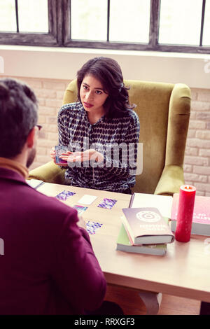 Nice attractive woman trying to help her client - Stock Photo