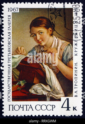 RUSSIA - CIRCA 1967: a stamp printed in Russia shows The Lacemaker, Painting by V. A. Tropinin, 1823, Russian Romantic Painter, circa 1967 - Stock Photo