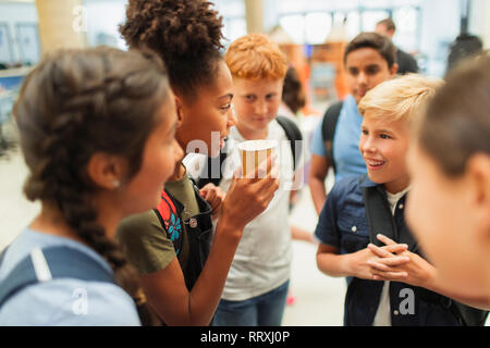 Junior high students hanging out, talking - Stock Photo