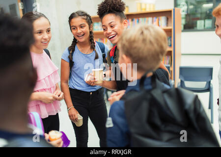 Junior high students talking, hanging out - Stock Photo