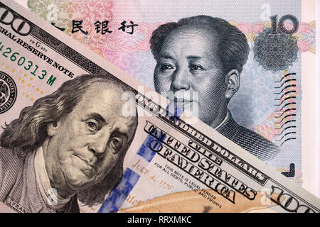 US dollar and chinese yuan. Concept for trade war or trading between China and the USA - Stock Photo