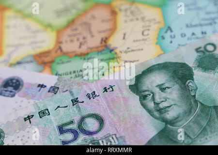 Yuan on the map of Africa. Chinese investment and trading, african economy, import and export - Stock Photo