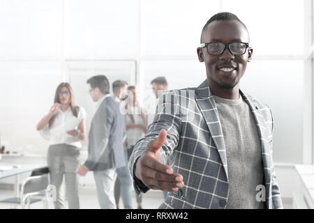 young businessman reaching out for a handshake - Stock Photo