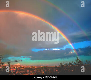Beautiful double rainbow over a village in Armenia - Stock Photo