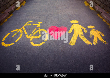 Together - bicycle and walkway with heart in Budapest on the Danube, Hungary - Stock Photo