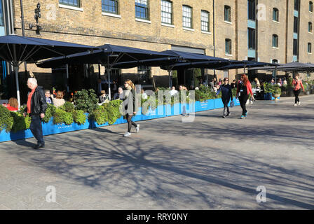 Early spring sunshine on Granary Square at Kings Cross, north London, UK - Stock Photo