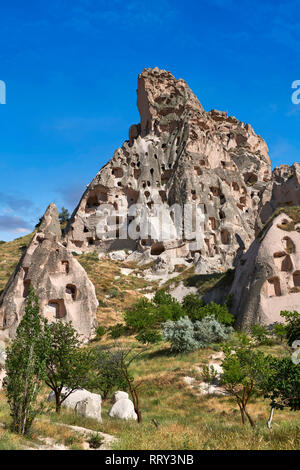 Pictures & images of the cave city houses in the rock formations & fairy chimney of Uchisar, near Goreme, Cappadocia, Nevsehir, Turkey - Stock Photo