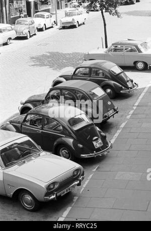 VW Beetle - VW Käfer unterwegs  -  Parkplatz - III - Stock Photo