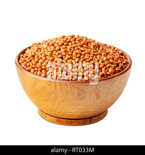 Millet with shells in a wooden bowl isolated on white - Stock Photo