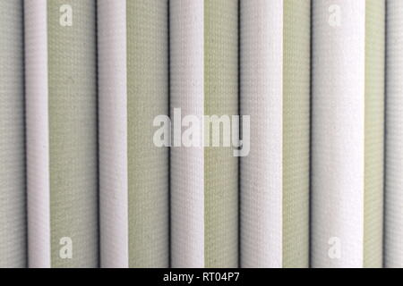 background photo of vertical lines that belong to grey cloth blinds - Stock Photo