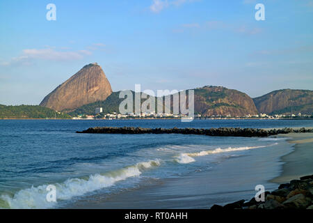 Sugarloaf Mountain and Urca Hill, famous Natural Monument in the city of Rio de Janeiro, Brazil - Stock Photo