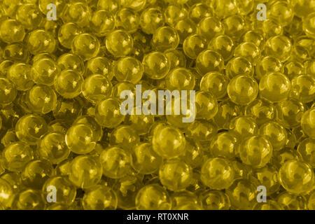 Water purple gel balls with bokeh. Polymer gel. Silica gel. Balls of purple hydrogel. Crystal liquid ball with reflection. Purple balls texture backgr - Stock Photo