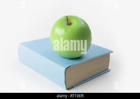 close up.book and green Apple on white background - Stock Photo