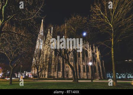 Vienna, Austria - December 25, 2017. Neo - gothic twin tower Votivkirche Illuminated at Night with no people. Facade of gothic Votive church, Sigmund  - Stock Photo