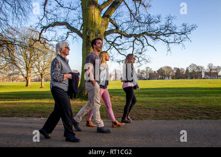 Northampton. U.K. 27th February 2019. Weather. People enjoying the late afternoon sunshine in Abington Park with long shadows as the sun begins to get lower in the sky. Credit: Keith J Smith./Alamy Live News - Stock Photo