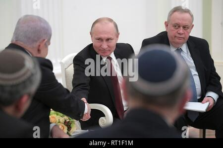 Moscow, Russia. 27th Feb, 2019. Russian President Vladimir Putin shakes hands with Israeli Prime Minister Benjamin Netanyahu during a bilateral meeting at the Kremlin February 27, 2019 in Moscow, Russia. Credit: Planetpix/Alamy Live News - Stock Photo