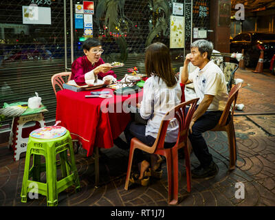 Bangkok, Bangkok, Thailand. 27th Feb, 2019. A fortune teller predicts a woman's future on a street corner in Bangkok's Chinatown. Bangkok, a city of about 14 million, is famous for its raucous nightlife. But Bangkok's real nightlife is seen in its markets and street stalls, many of which are open through the night. Credit: Jack Kurtz/ZUMA Wire/Alamy Live News - Stock Photo