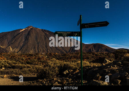 Volcanic landscape lit by the full moon in the middle of the night at the Las Canadas del Teide national park, Tenerife, Canary Islands, Spain - Stock Photo