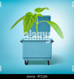 3d rendering of a green sprout growing in a blue trash can. - Stock Photo