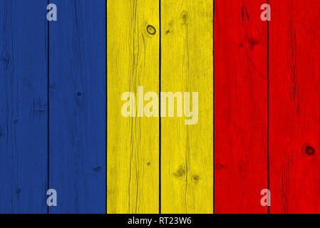 Chad flag painted on old wood plank. Patriotic background. National flag of Chad - Stock Photo