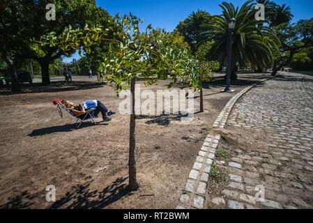 Buenos Aires, Argentina - 1 Apr, 2017: A Woman is sunbathing in the Palermo Woods urban park (Spanish: Bosques de Palermo, Parque Tres de Febrero). - Stock Photo