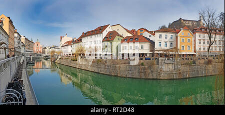 Panoramic view on Ljubljanica river canal in Ljubljana old town. Ljubljana is the capital of Slovenia and famous tourist destination in Slovenia - Stock Photo
