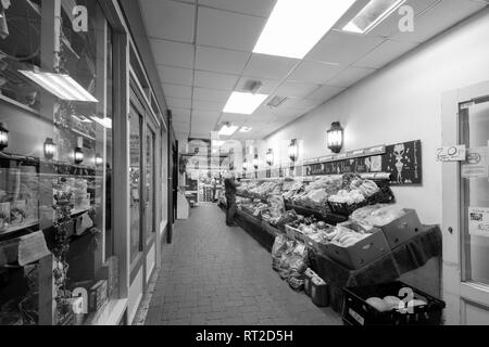 A man shopping in the Happy Apple fruit and veg shop in Totnes,south Devons. - Stock Photo