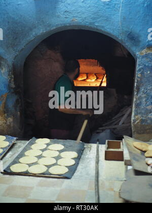 Baking bread in Fez Medina, Morocco - Stock Photo