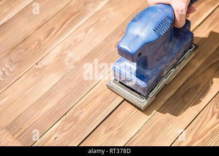 Blue grinder on wooden floor - Stock Photo