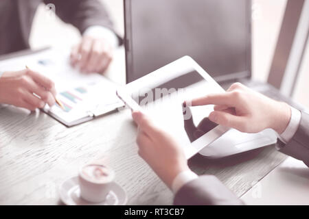 close up.the businessman uses a digital tablet - Stock Photo