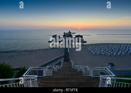 Germany, Mecklenburg-Western Pomerania, Ruegen, Sellin, view to sea bridge at sunset - Stock Photo