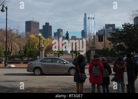 People looking at and taking pictures of the George Washington Statue, Boston Public Garden, Arlington Street, Boston, Massachusetts - Stock Photo