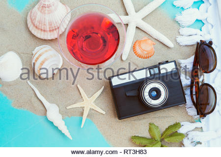 Summer background with cocktail and the vintage camera - Stock Photo
