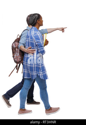 Side view of interracial going couple who points somewhere. Two students go to the lecture. Rear view people collection. backside view of person. Isol - Stock Photo