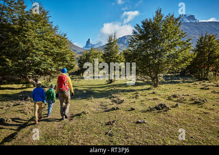 Chile, Cerro Castillo, mother with two sons on a hiking trip - Stock Photo