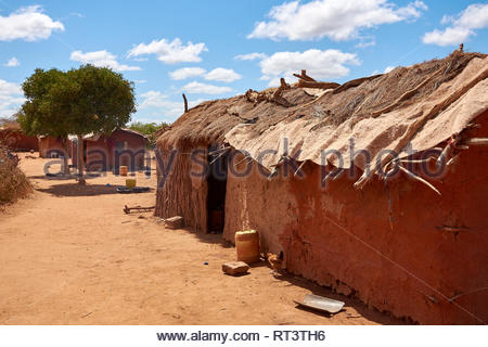 View of an old masai village with huts of clay. Poverty and misery in Kenya in Africa - Stock Photo