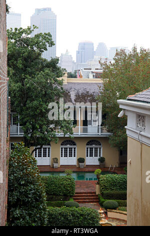 a view of a nice French style house with swimming pool in the French Quarter of New Orleans, USA - Stock Photo