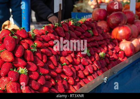 Ripe stawberries pile on a street market stall, Athens Greece - Stock Photo