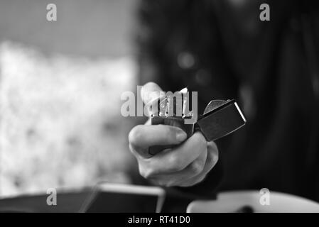 Zippo lighter in a hand - Stock Photo