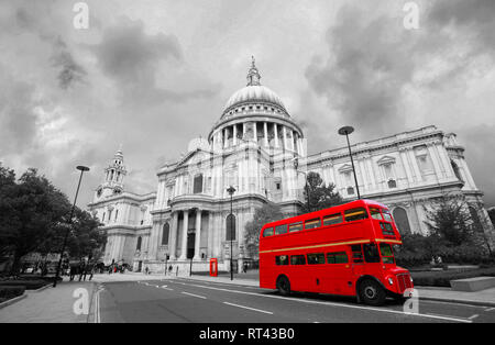 London St Paul's Cathedral and iconic Routemaster Bus present over dramatic sky. - Stock Photo