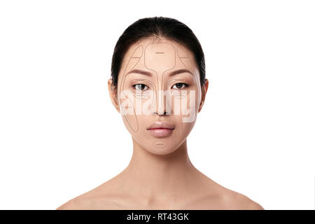 Contouring. Make up asian woman face on white background. Contour and highlight makeup. Professional face make-up sample - Stock Photo