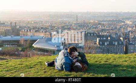 Edinburgh, Scotland, UK. 26 February, 2019. Tourists enjoy view of Leith from Calton Hill in Edinburgh after a clear day , Edinburgh, Scotland, UK - Stock Photo
