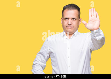 Middle age arab elegant man over isolated background doing stop sing with palm of the hand. Warning expression with negative and serious gesture on th - Stock Photo