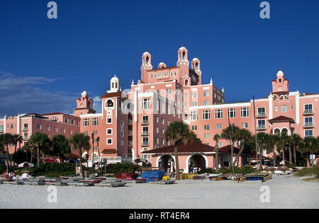 Appropriately called the Pink Palace, The Don Cesar is a splendid beach resort and spa that sprawls along a sandy shore of the Gulf of Mexico at St. Pete Beach on the west coast of  Florida, USA. Celebrities and other members of high society flocked to the landmark lodging in the Tampa Bay area when it opened in 1928 during the Sunshine State's early boom years. Beginning in 1942 the grand hotel was used as a hospital and convalescent center for wounded World War II soldiers before falling into disrepair. New owners in 1973 restored the towered nine-story hoitel to its former glory. - Stock Photo