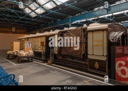 Travelling Post Office (TPO) carriage (1880's-1930's) on display in the National Railway Museum, York, UK. - Stock Photo