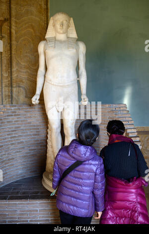 Two Tourists Admire Statue of Antinous (c111-130AD), Bithynian Greek Youth & Favourite of Roman Emperor Hadrian, Egyptian Museum Vatican Museums - Stock Photo