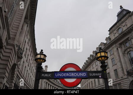 point of view of one of the underground train entrances in one of the most famous streets in London during the cloudy day during winter 2019 - Stock Photo