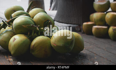 Sweet green coconuts. Coconut tropical fruit for drink in China - Stock Photo