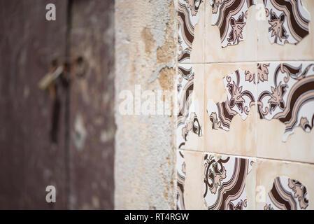 Azulejos Portuguese exterior wall tiles in Tavira, Portugal. Traditional decorative azulejos wall ceramic tiles - Stock Photo